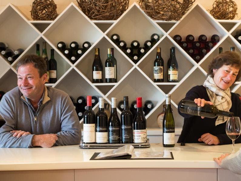 Rolf Binder Wines_20160822_High Res-3_RB & Christa at bar_crop-min